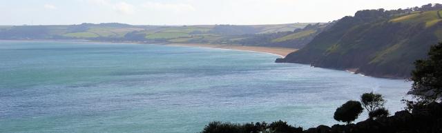 View ahead to Slapton Sands, Ruth walking around the coastline. Devon.