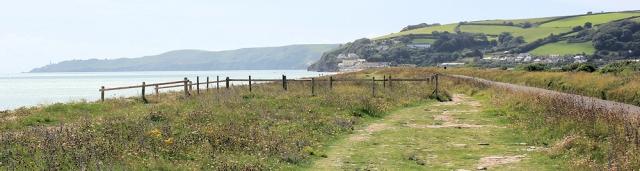 Torcross in distance, Ruth walking round the coast. DEVON