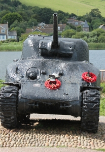 tank memorial at Slapton Sands, Torcross. Ruth walking the coast.