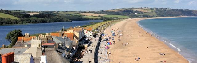 looking back along Slapton Sands, Ruth walks the coast, Devon.