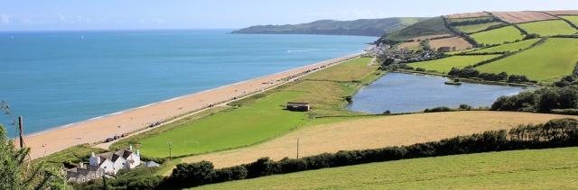View down to Beesands, Ruth walking the coast around Devon