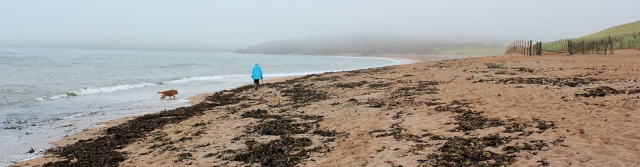 Thurlestone Beach, in the mist, Ruth walking the Devon Coast