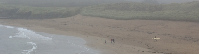 Bantham Beach in the mist, Ruth on her coastal walk. Devon