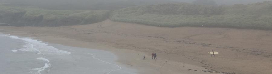 Bantham Beach in the mist, Ruth on her coastal walk. Devon