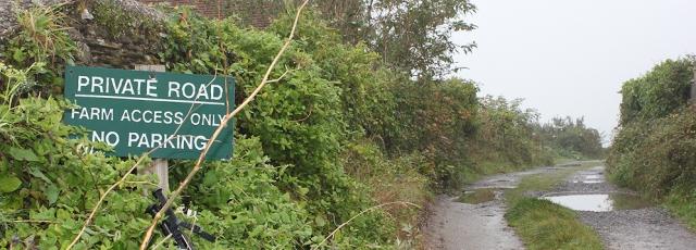 private farm track, Ruth trying to walk the coastline of Devon.
