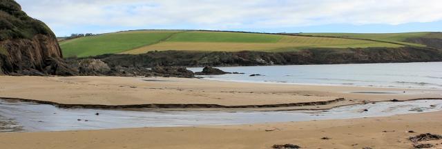 Mothecombe Beach, South West Coast Path, Ruth walking through Devon