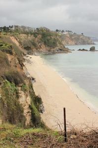 rain - Duporth Beach, Ruth walking the South West Coast Path
