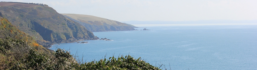 looking back across Whitsand Bay, Ruth walking round the coast, South West Coast Path