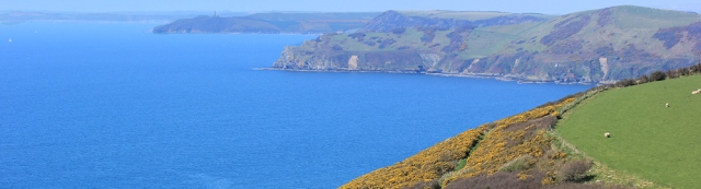 Pencarrow Head and Gribben Head, Ruth hiking the South West Coast Path