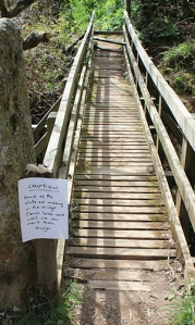 bridge with slats missing- sign on Ruth's walk, St Austell Bay