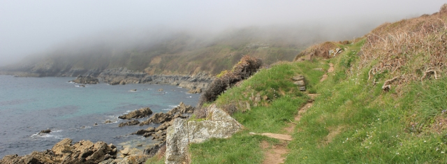 fog over Caragloose Point, Ruth walking on the SW Coast Path, Cornwall