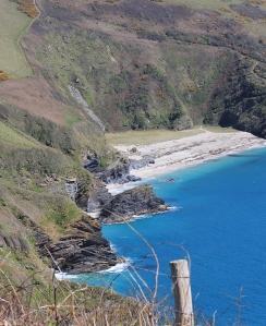 looking back on Lantic Bay, Ruth on the South West Coast Path