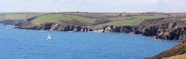 approaching Fowey, Ruth walking the UK coastline