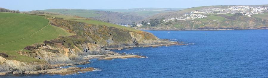 looking back to Polruan, Ruth walking around the coast of Cornwall