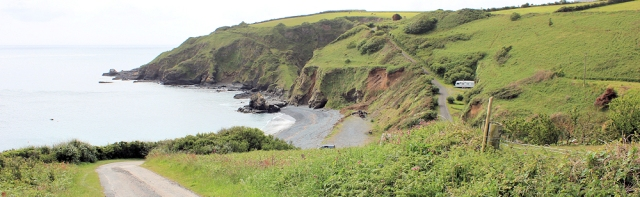 06 Pencra Head, Porthkerris Point, Ruth walking round the coast
