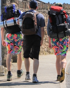 15 boys with bright shorts, overtaking Ruth Livingstone
