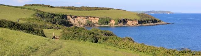 23 last look back to Rosemullion Head, Zone Point and Nare Head, Ruth walking the SW Coast Path