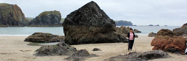 Kynance Cove, rocks, Ruth on her coastal walk SWCP