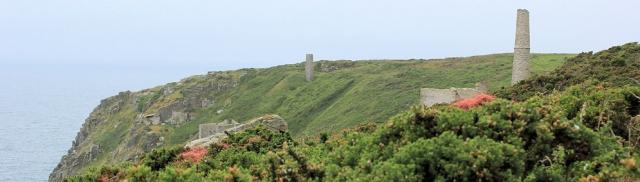 closer to tin mines, Ruth walking the coast