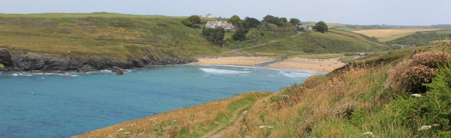 Poldhu Cove, Ruth on her coastal walk in Cornwall