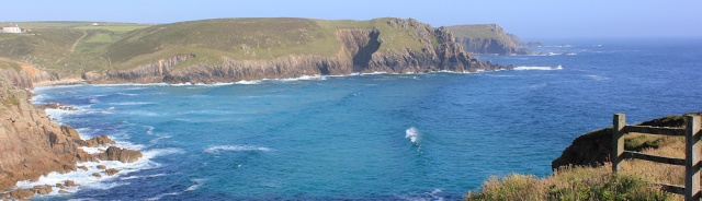Looking back from Lands End, Ruth on her coastal walk
