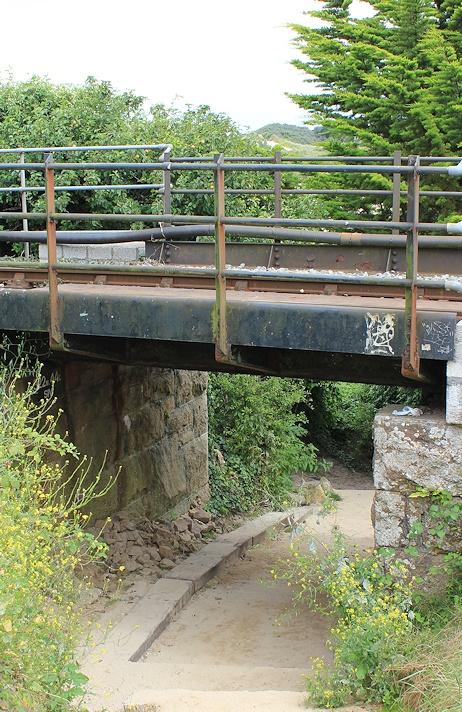 under railway bridge, Ruth on her coastal walk