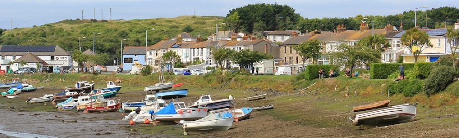 Hayle riverside, Ruth walking the South West Coast Path