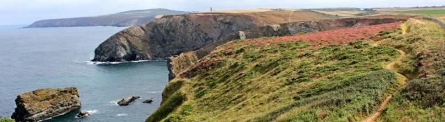 Gullyn Rock, towards Agnes Head, Ruth walking the South West Coast Path