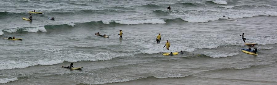 surf school on beach, Cornwall, Ruth walking the SWCP