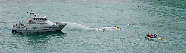 Spraying the surf boarders, St Agnes, Ruth Livingstone