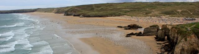Perranporth Beach, Ruth walking the coast