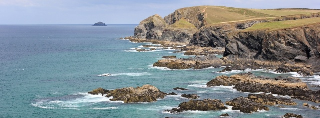 Looking to Gunver Head from Trevone, Ruth walking in Cornwall