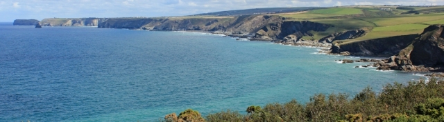 04 view ahead to Tintagel across Port Isaac Bay, Ruth on SWCP
