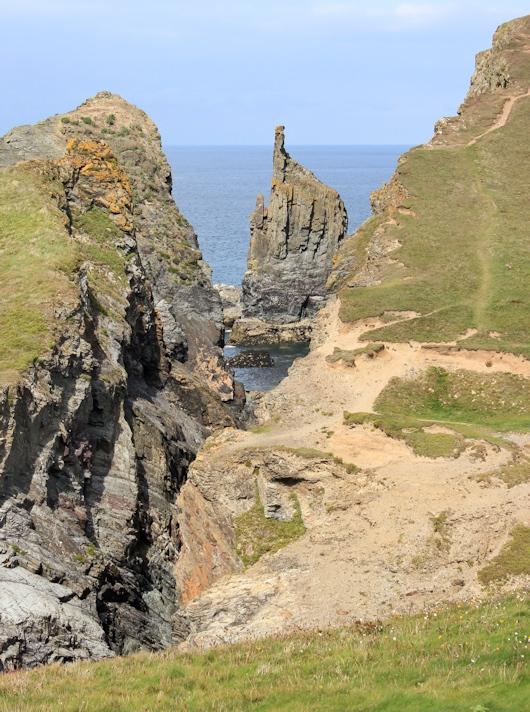rocks Longcarrow Cove, Ruth walking the Cornish coast