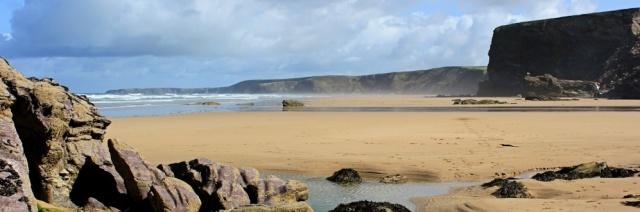 along Watergate Beach, Ruth walking the coast, Cornwall