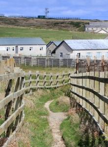 walking through Penhale Camp, Ruth on SWCP