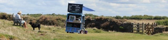 Coffee van, near Dinas Head, Ruth walking the coast