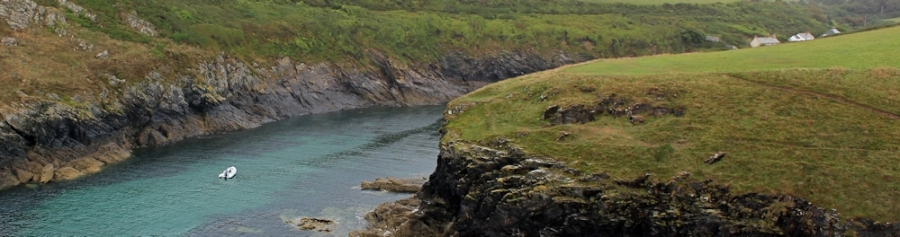 into Port Quin, Ruth walking the coast, Cornwall SWCP