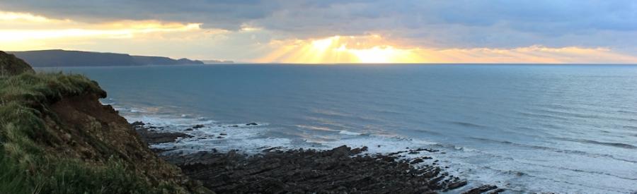 Sunset over Tintagel, Ruth on her coastal walk, Cornwall