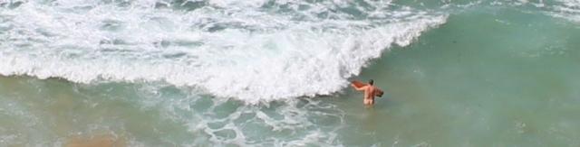 nude surfboarder, Carnewas, North Cornwall
