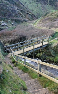 bridge at Marsland Mouth, Ruth on her coast walk