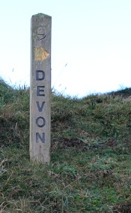 Devon signpost, Marsland Mouth, Ruth walking the coastal pat