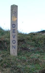 10c Devon signpost, Marsland Mouth, Ruth walking the coastal pat