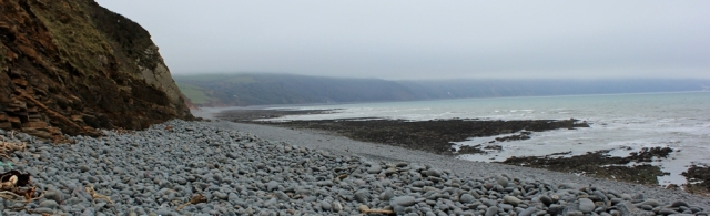 view back to Peppercombe, Ruth walking the coast path, North Devon