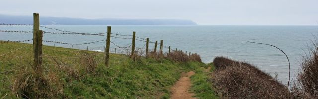 on Green Cliff looking back to Hartland Point, Ruth on coastal walk, SWCP, North Devon