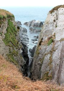 sharp rocks and cliffs, Ruth on the Tarka Trail, North Devon
