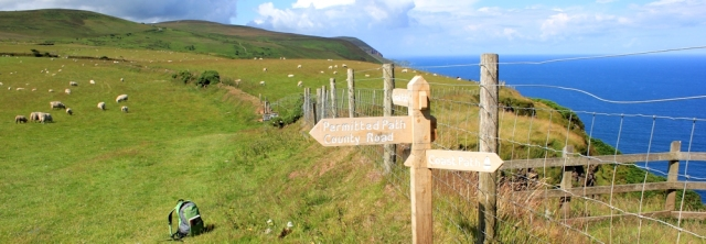 signposts on the SWCP, north Devon, Ruth walking around the UK