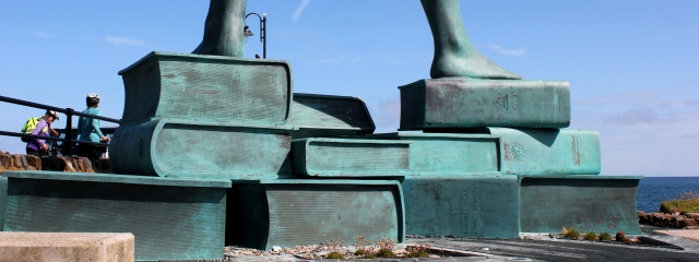 Statue stands on books, Ruth's coastal walk in Ilfracombe