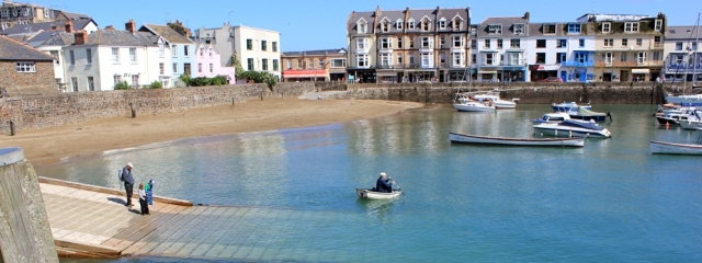 across Ilfracombe harbour, Ruth walking through Devon
