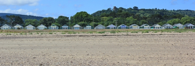 beach huts along Dunster Beach, Ruth walking the Somerset Coast Path